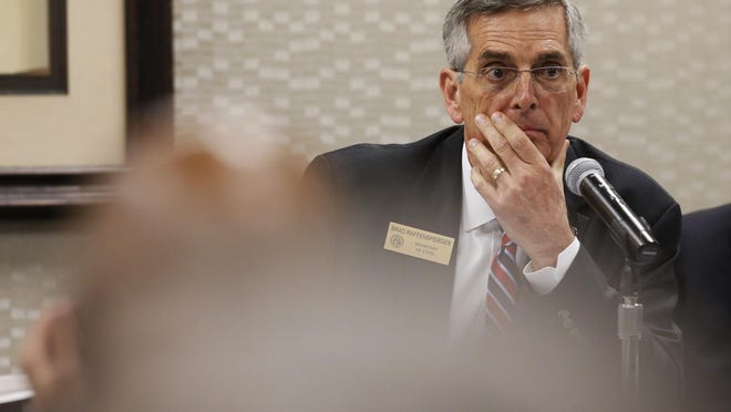 Georgia Secretary of State Brad Raffensperger looks on during a State Elections Board hearing in Athens in March.