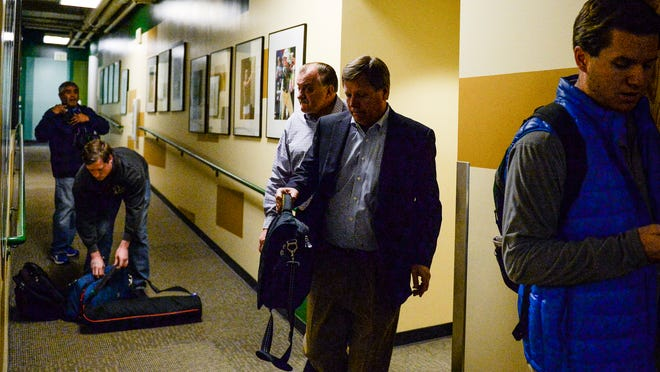 Jim McElwain leaves a players meeting in the Fum McGraw Athletic Center on Thursday.