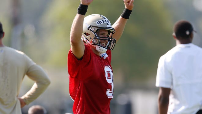 New Orleans Saints quarterback Drew Brees (9) reacts during football practice in Metairie on Thursday.