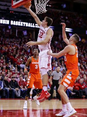 Wisconsin's Ethan Happ (22) shoots against Syracuse's Andrew White (3) and Tyler Lydon, right, during the second half Tuesday. Happ had a game-high 24 points in Wisconsin's 77-60 win.