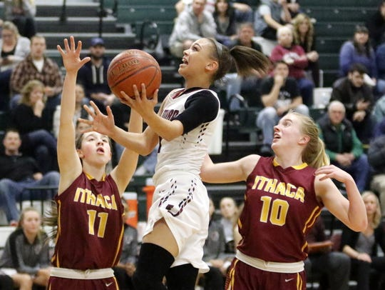 Kiara Fisher of Elmira goes up for a layup in between