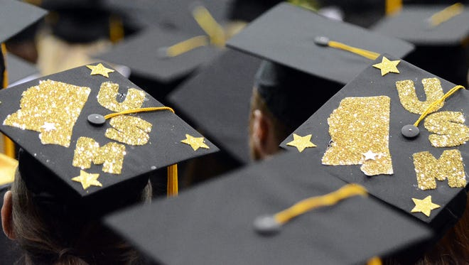 This is a file photo of University of Southern Mississippi graduates.