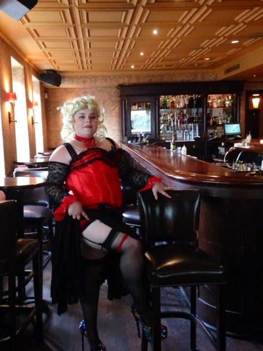 Tease of burlesque coyly walks stripping's fine line