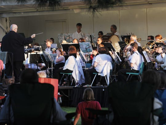 Mike Gangemi, guest conductor, leads the Camarillo Community Band at a free concert in September 2017.