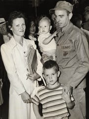 In an August 1950 photograph, Sgt. Emerson Stewart of Oak Ridge stands with his wife and children as he prepares to depart from the Southern Station on Depot Avenue after his 19th Engineer Marine Reserves unit was called up for active duty in the Korean War.