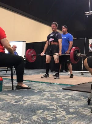 Pensacola's Larry Tilley, 65, competes at last weekend's Gulf Coast Beach Powerlifting Classic at Orange Beach, Alabama, where he set American record for squat lift.