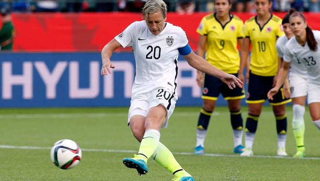 United States forward Abby Wambach (20) kicks a penalty kick during the second half against Colombia in the round of sixteen in the FIFA 2015 women's World Cup soccer tournament at Commonwealth Stadium.