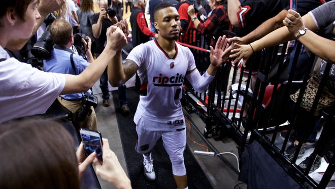 Portland Trail Blazers guard Damian Lillard walks off the court after Game 6 of the team's NBA basketball first-round playoff series against the Los Angeles Clippers on Friday, April 29, 2016, in Portland, Ore. The Trail Blazers won 106-103. (AP Photo/Craig Mitchelldyer)