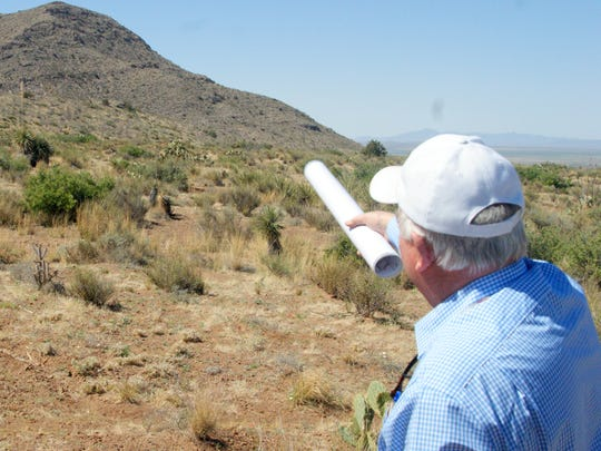 David Tognoni, founder and spokesman of American Magnesium, gestures toward one of the foothills targeted for a proposed dolomite mine in the Florida Mountains.