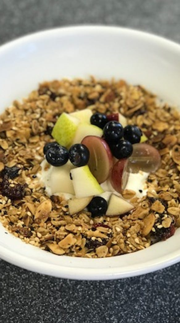 Fresh fruit tops granola for brunch at The Pour House
