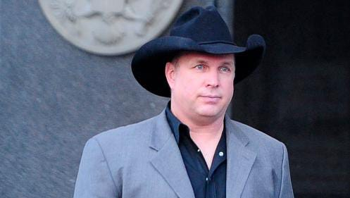 Garth Brooks leaves the Estes Kefauver Federal Building. A former employee says Brooks gave her money for legal fees.