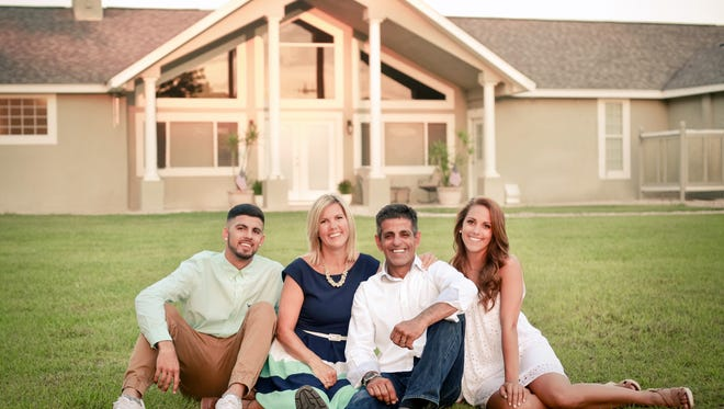 The Blanco family pose for a photo in front of the home they built in Taylor County. Pictured from left are Noah Blanco, Shelly Blanco, Rudy Blanco and Hannah Blanco.