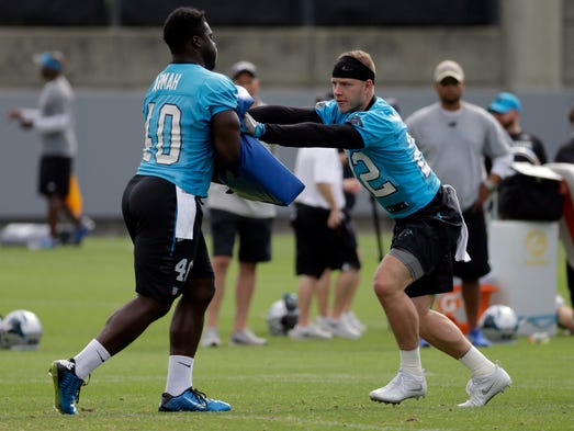 Carolina Panthers' Christian McCaffrey, right, runs