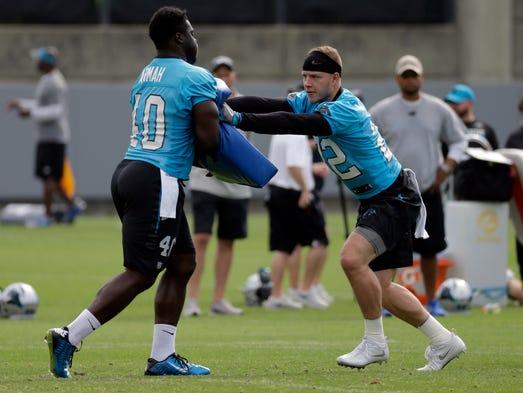 Carolina Panthers' Christian McCaffrey, right, runs
