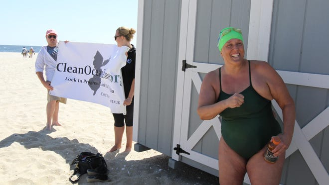 Patricia Sener, executive director of Coney Island Brighton Beach Open Water Swimmers, talks to the media before the start of her 17 mile swim across the Western New York Bight to bring attention to Clean Ocean Action's Clean Ocean Zone Initiative, which seeks to create the first-ever pollution-free ocean area, at Sandy Hook's North Beach Wednesday July 22, 2015.