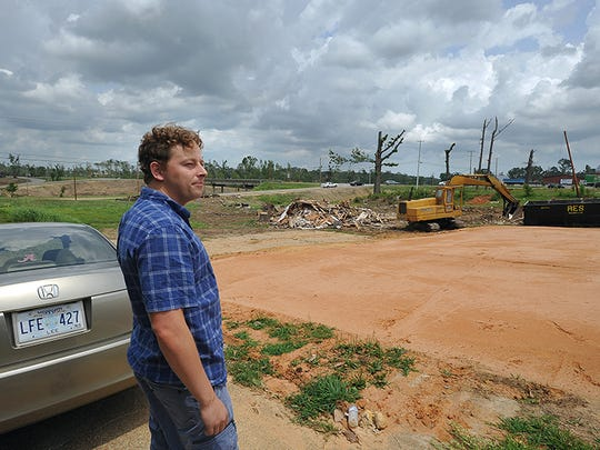 Kevin Barnes looks over the slab on Clayton Avenue where his home was destroyed in the April tornado that hit Tupelo.