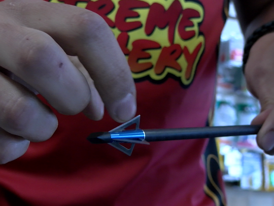 Xtreme Archery owner Nathan Reider handles a fixed