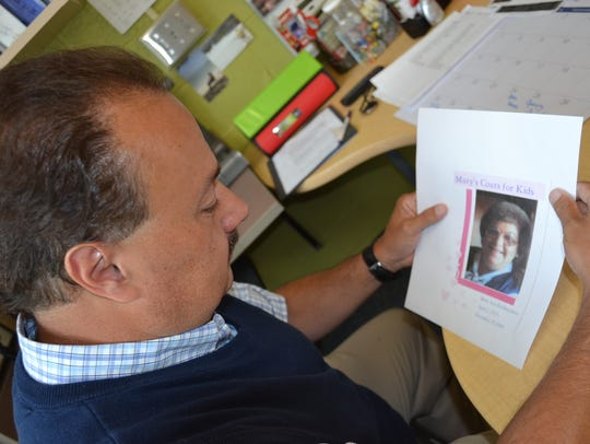 Mike Ferdinandsen looks at a photo of him mother, Mary