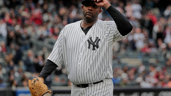 New York Yankees pitcher CC Sabathia acknowledges applause from the crowd as he walks off the field during the eighth inning of a baseball game against the St. Louis Cardinals, Saturday, April 15, 2017, in New York. The Yankees won 3-2. (AP Photo/Julie Jacobson)