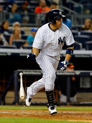 May 8, 2015; Bronx, NY, USA; New York Yankees right fielder Carlos Beltran (36) tosses his bat after hitting an RBI double in the third inning against the Baltimore Orioles at Yankee Stadium. Mandatory Credit: Noah K. Murray-USA TODAY Sports