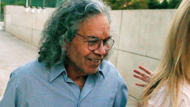 In this Oct. 26, 2017 file photo, Insys Therapeutics founder John Kapoor leaves U.S. District Court in Phoenix. He is being sued by New Jersey's Attorney General.