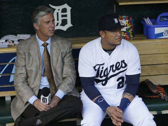 Then-general manager Dave Dombrowski talks with Miguel Cabrera before an interleague game in 2014.