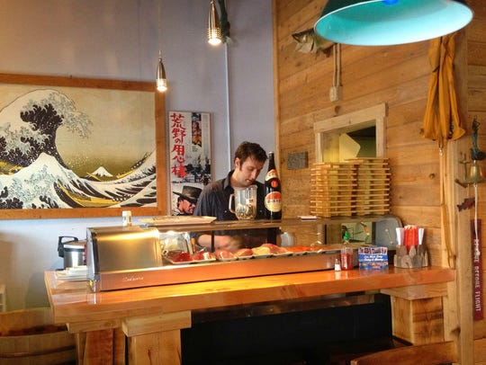 Clint Viers rolls the sushi that pairs so well with