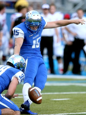 MTSU's kicker Canon Rooker (15) kicks an extra point in the game against WKU on Saturday, Oct. 15, 2016.