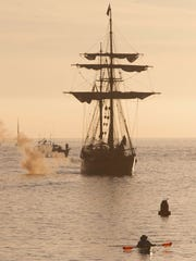 The tall ship Hawaiian Chieftain fires its cannon as it sails into Ventura Harbor in 2015.