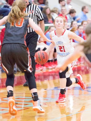 Greenfield's Tess Darby (10) defends Gibson County's Allie Smithson (21) earlier this season.