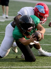 Wichita Falls High School's Zach Williams scores a touchdown while being tackled by a Hirschi defender in a scrimmage Friday, Aug. 25, 2017, at Memorial Stadium.