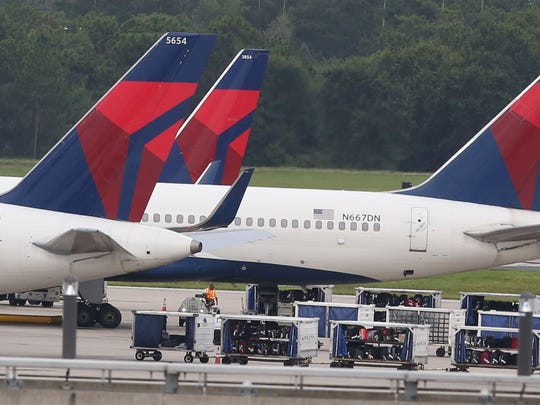 Delta Air Lines sit at Orlando International Airport on Aug. 8, 2016.