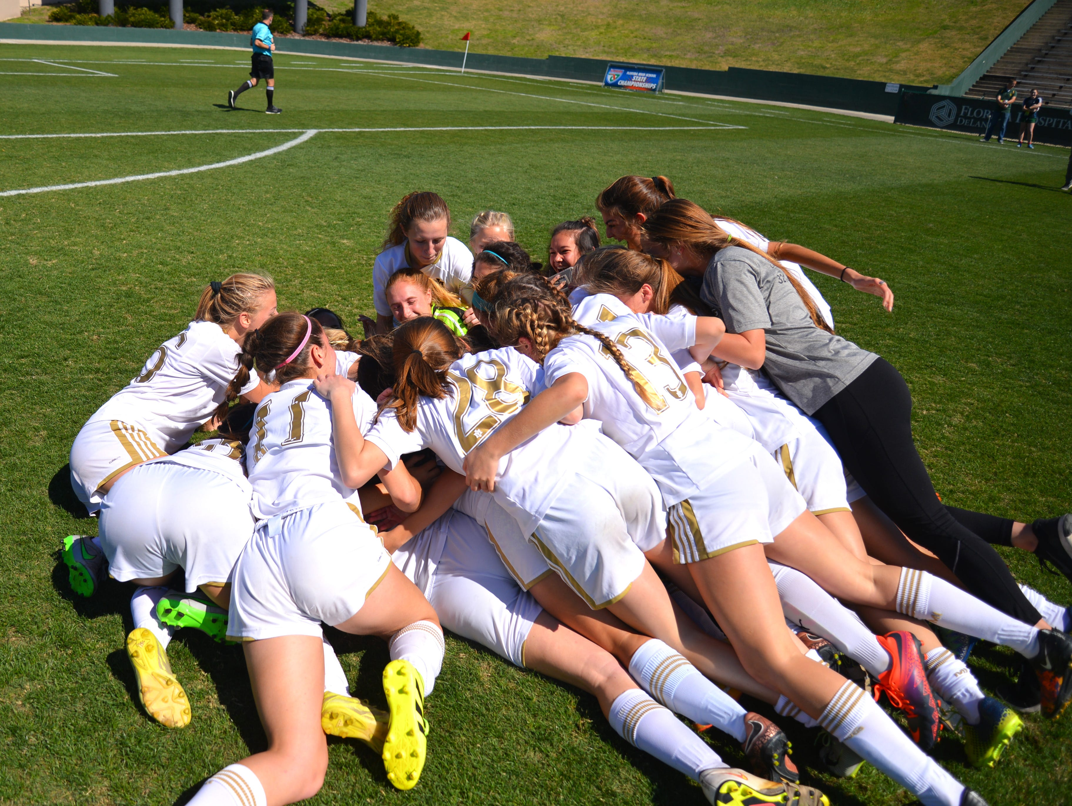 The Merritt Island High girls soccer team celebrates after winning the 3A state championship on Friday, Feb. 17, 2017.