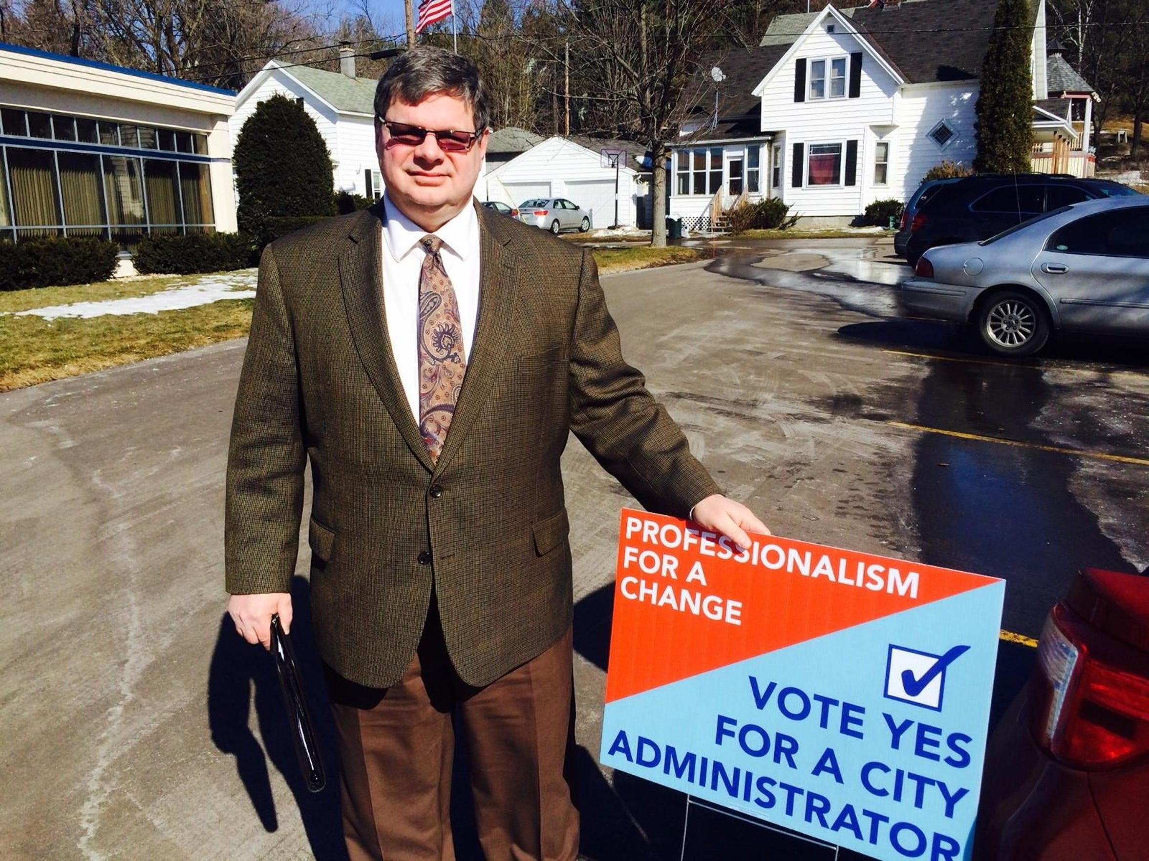 City Council member Keene Winters holds a sign advocating for a city administrator in Wausau in this March 10, 2015, file photo.