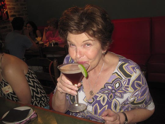 Kathey Hunter sips some wine during a recent Cajun Food Tour.