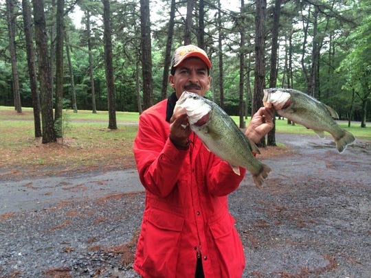 Daniel Garcia shows off a couple nice bass he caught on a recent fishing trip.