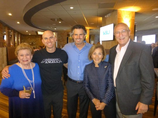 Variety the Children's Charity Board member and Birmingham resident Judy Solomon, Imerman Angels founder Jonny Imerman of Chicago, event co-chair Jeffrey Imerman of Birmingham, Imerman Cake Co. owner Jayne Imerman of Bloomfield Hills and Variety Board member Michael Bressler of Birmingham.