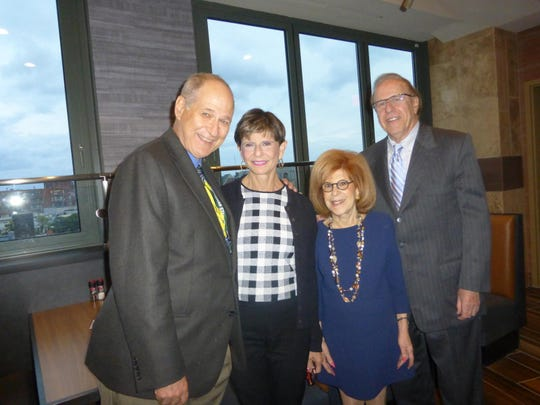 Dr. Lewis Rosenbaum, an internist at Beaumont Hospital, and his wife, Leslye of West Bloomfield; and event co-chair Lois Shaevsky and her husband, Mark, of Bloomfield Hills. Beaumont Children's Hospital is one of the four charity recipients of the Palladium and Ironwood Grill opening fundraisers