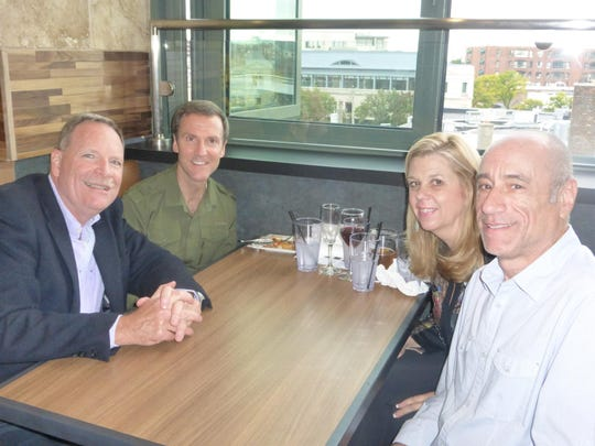 Farmington Hills residents Ron and Linda Hatfield and Bloomfield Hills residents Dave Weir and Birmingham Tiffany Florist owner Bob Kupfer were among the first group of patrons to enjoy the new Emagine Palladium and Ironwood Grill.