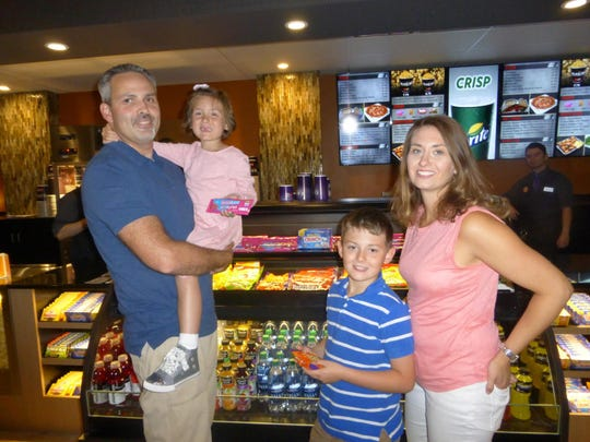 "Charlie, Ellie, 6, Carter, 9, and Cathy Rupert of Rochester Hills. When Ellie was diagnosed with Ewing sarcoma at age 41/2, her family all became involved with Kids Kicking Cancer, one of the four charity recipients of the Palladium and Ironwood Grill opening parties. ""They empowered us when we were powerless,"" said Cathy Rupert. ""They gave us peace and purpose."""