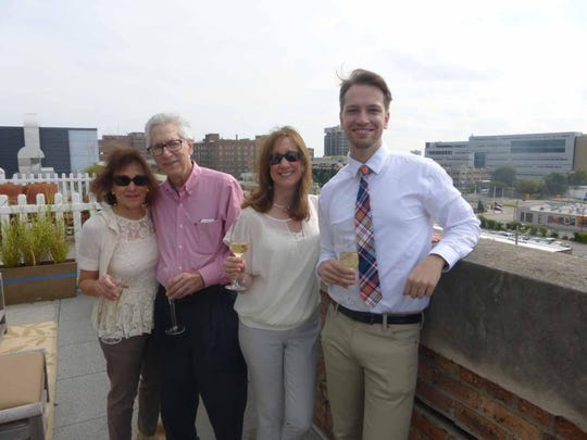 Josette and Joel Silver of Franklin, Suzanne Dalton of Dearborn and Colin Payne of Detroit enjoyed mimosas on Jeff Antaya's and Peter Rosenfeld's terrace overlooking the Detroit skyline.