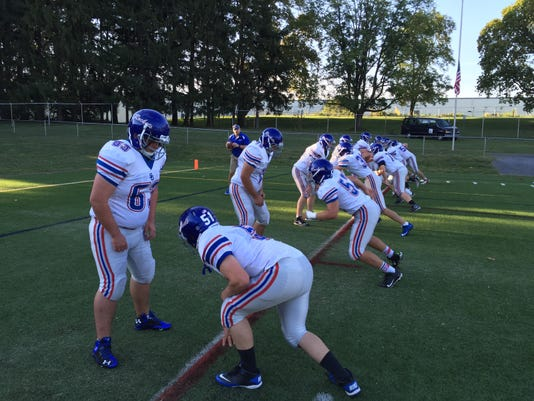 Spring Grove players warm up before Friday's game against Mechanicsburg. The Rockets won, 17-14, on a 45-yard field goal by Andrew Luckenbaugh.