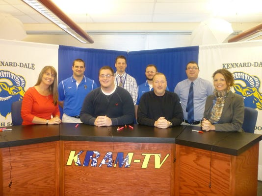 Matt Belt received a grant-in-aid for football to attend Shippensburg University next fall. Pictured, from left in the first row: Raquel Stolba, mother, Matt Belt, George Belt, father, and Heather Venne, principal. Second row: Eric Updegrove, asst. football coach, Dr. Zane Fake, asst. principal, James Waltermeyer, asst. football coach, and Patrick Weider, new head football coach. (SUBMITTED)