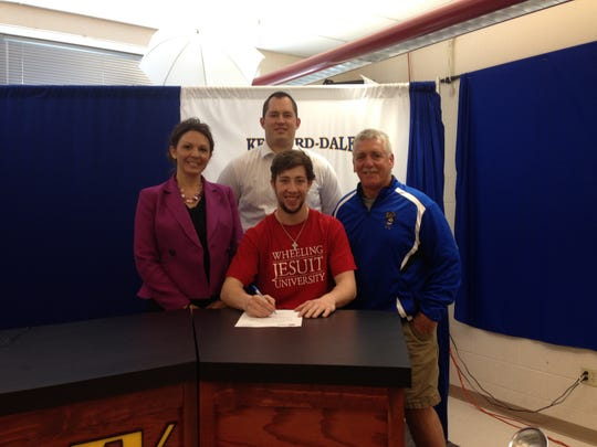 Kennard-Dale boys' lacrosse player David Wallace, center, recently signed a letter of intent to play men's lacrosse for Wheeling Jesuit University. Pictured are, from left, principal Heather Venne, athletic director Gary McChalicher and coach Tom Nelson. (SUBMITTED)