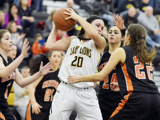 Red Lion's Amy Maciejewski (20) is swarmed by Central York defenders including Lydia Shellenberger (24) and Sarah Sepic (22) in the second half of a YAIAA girls basketball game on Friday, Jan. 16, 2015. The Lady Lions struggled on offense in 30-18 defeat to the Panthers. Jeff Lautenberger Ñ For GameTimePA.com