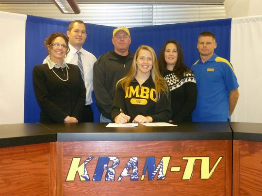 Sara Tarbert will play Division I basketball for UMBC. Pictured are, from left, principal Heather Venne, athletic director Gary McChalicher, father Tim Tarbert, Sara Tarbert, mother April Tarbert  and coach Jeff Stratmeyer.