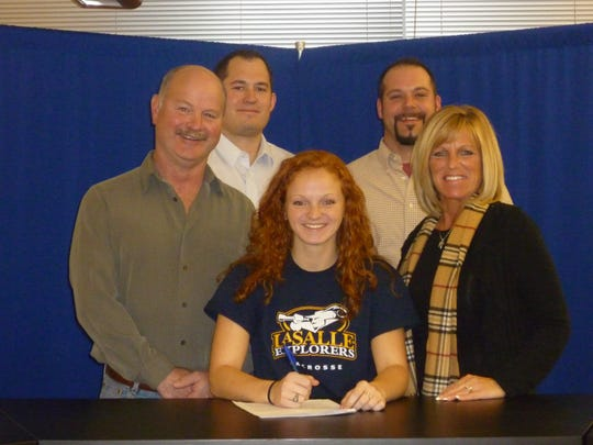 K-D girls' lacrosse player Nicole Black will continue her career in college at LaSalle. Pictured are, left to right - father Ray Black, athletic director Gary McChalicher, Nicole Black, coach Barry Mitchell and mother Deb Parsley. Head coach Kelly Wetzel was unable to make the photo.