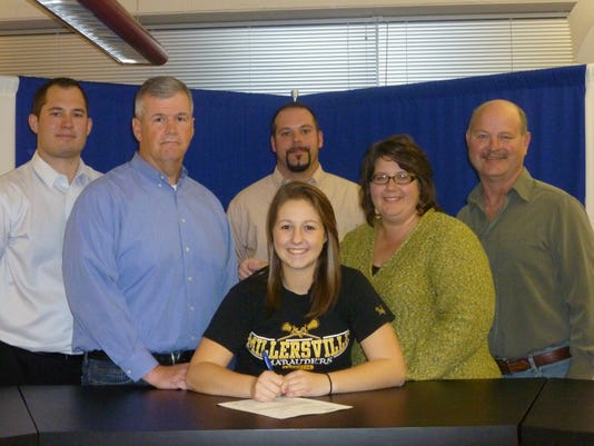 K-D girls' lacrosse player Taylor Davis signed her letter of intent to play at Millersville. Pictured are, left to right, athletic director Gary McChalicher, father William Davis, Taylor Davis, coach Barry Mitchell, mother Karen Davis and club coach Ray Black. Rams head coach Kelly Wetzel was unable to make the photo.