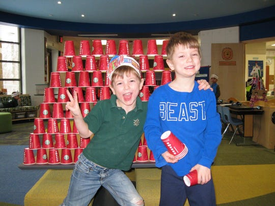 Twins Reilly and Sean Smith stack 100 cups.