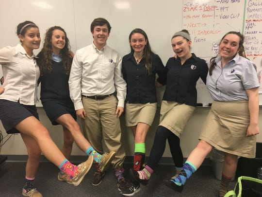 Newark Charters RESPECT Club members, moderated by teacher Lauren Maskery, sold almost 300 pairs of socks to raise money and spread awareness about Down Syndrome.